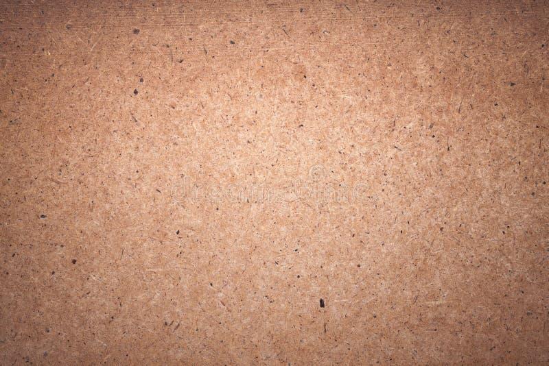 Struttura approssimativa del fondo del primo piano dello strato del cartone immagine stock
