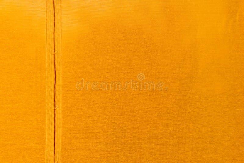 Struttura arancio del tessuto immagini stock
