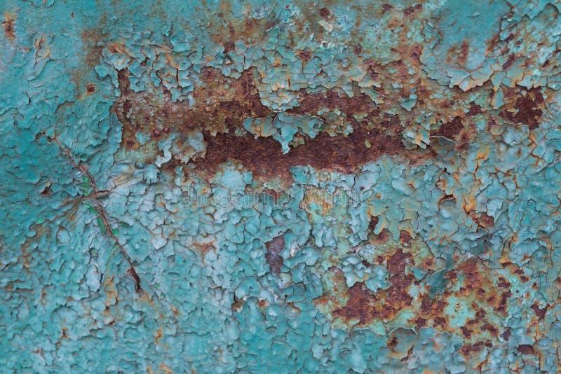 Struttura arrugginita del metallo con pittura blu incrinata fotografie stock libere da diritti