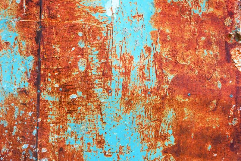 Struttura arrugginita della superficie di metallo di lerciume arancio e di Teal fotografia stock libera da diritti