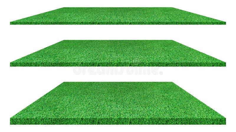 Struttura artificiale dell'erba verde isolata su fondo bianco fotografia stock