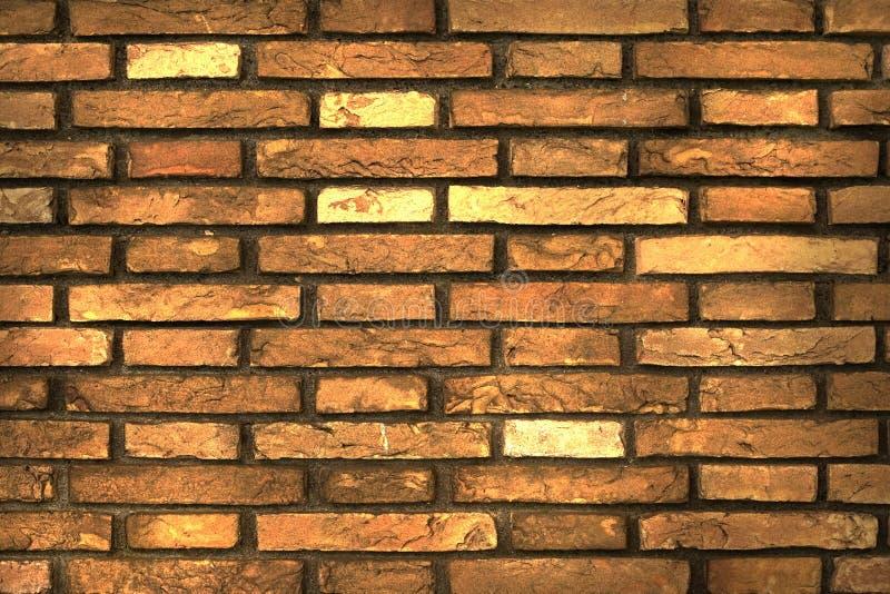 Struttura artistica del muro di mattoni sul lato di vecchia costruzione immagini stock libere da diritti