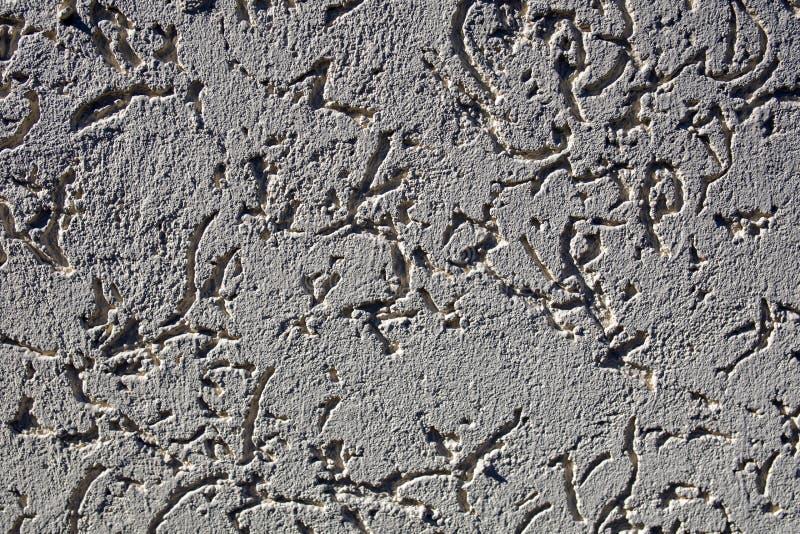 Struttura astratta approssimativa grigia e bianca dello stucco, fondo fotografie stock libere da diritti