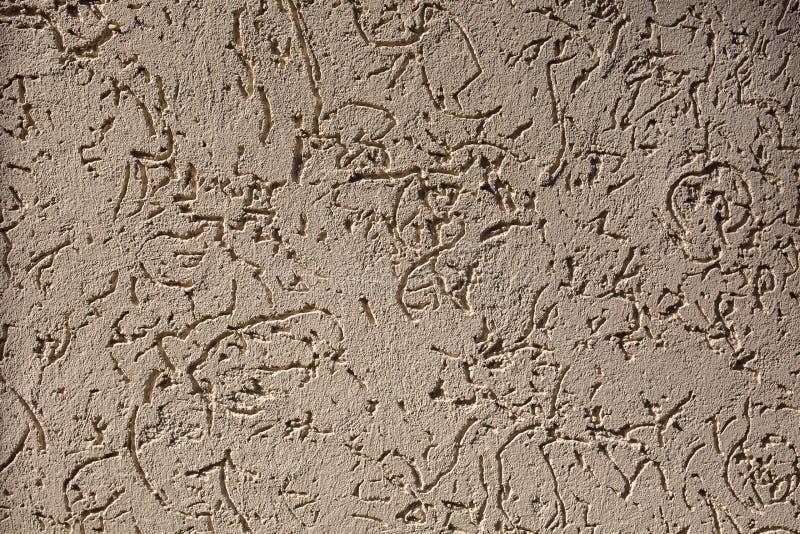 Struttura astratta approssimativa grigia e bianca dello stucco, fondo fotografie stock