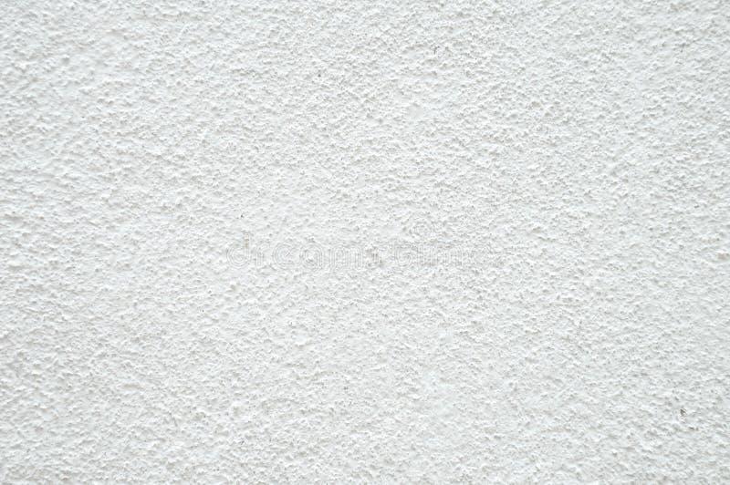 Struttura bianca approssimativa del muro di cemento come fondo fotografie stock libere da diritti