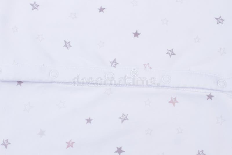 Struttura bianca dei vestiti del bambino fotografia stock