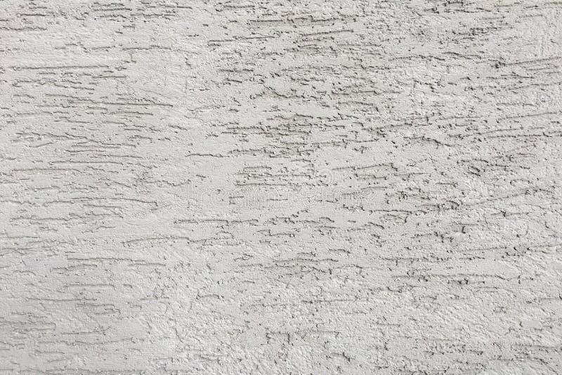 Struttura bianca della parete dello stucco Effetto decorativo del gesso sul fondo della parete immagine stock libera da diritti