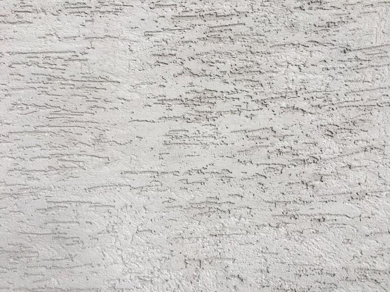 Struttura bianca della parete dello stucco Effetto decorativo del gesso sul fondo della parete immagine stock