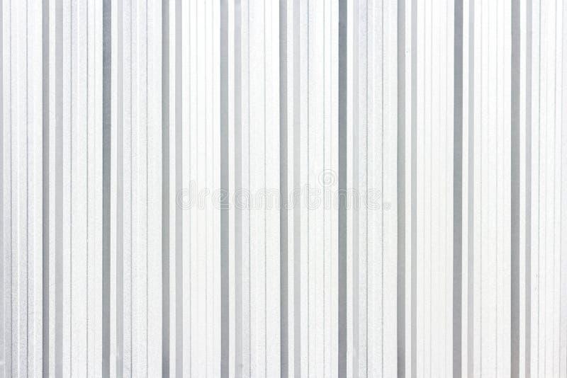 Struttura bianca e fondo di piastra metallica della parete senza cuciture immagine stock