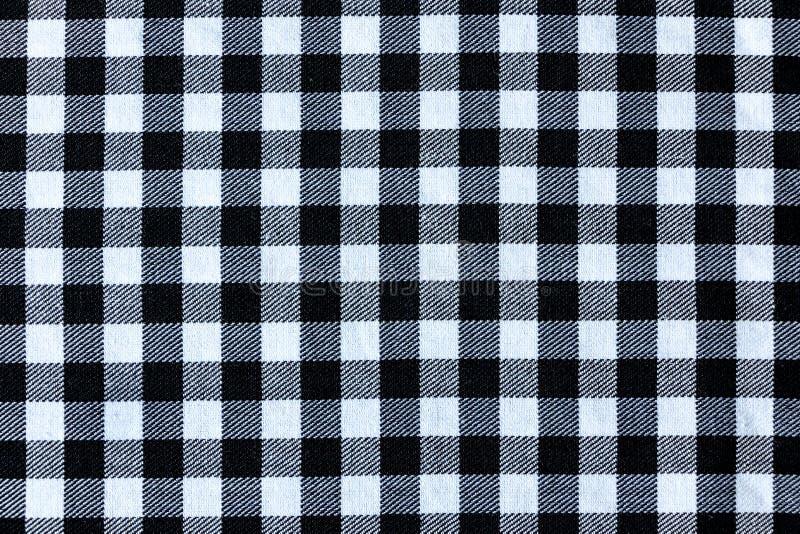 Struttura in bianco e nero del tessuto di tessuto del plaid fotografia stock libera da diritti