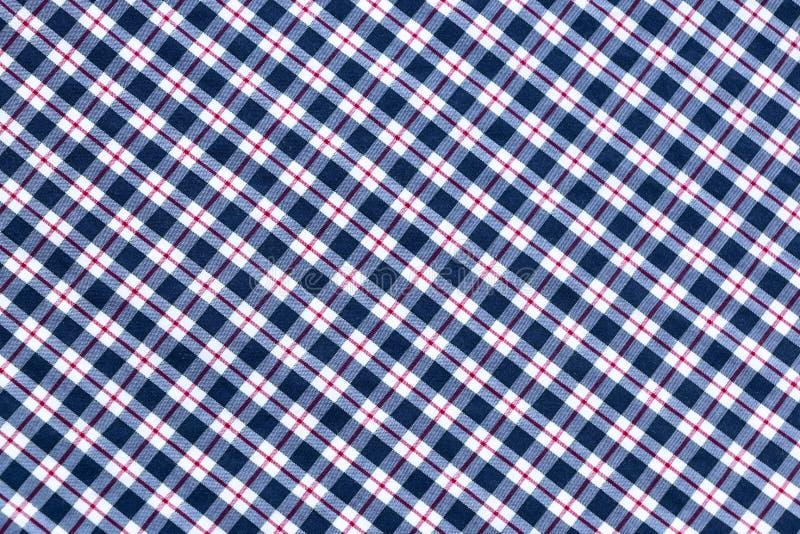 Struttura in bianco e nero e rossa del tessuto di tessuto del plaid fotografie stock libere da diritti