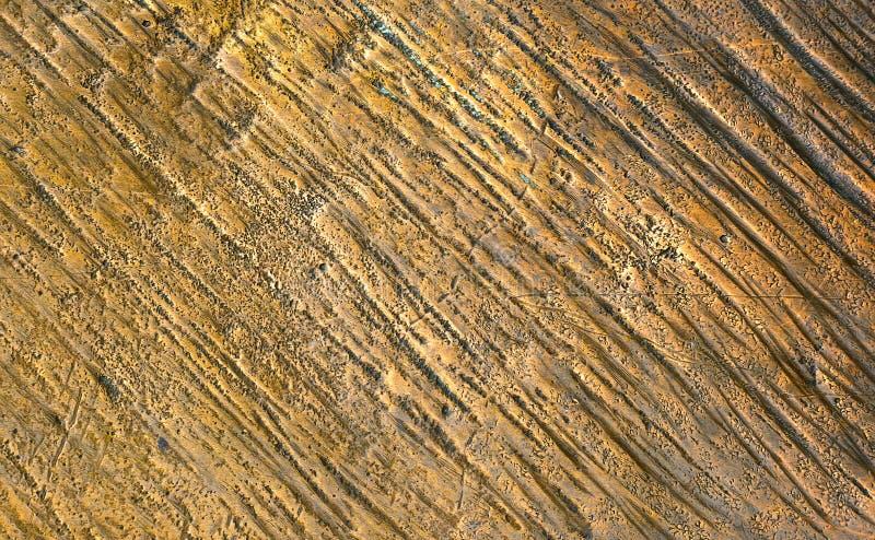 Struttura bronzea di vecchio fondo dorato della superficie di metallo immagine stock libera da diritti