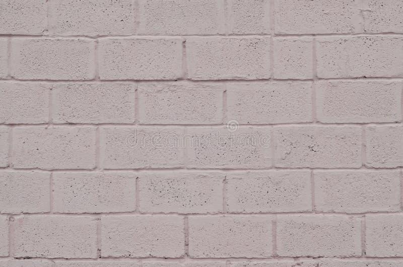 Struttura colorata stagionata e macchiata della parete del blocchetto di rosa immagini stock