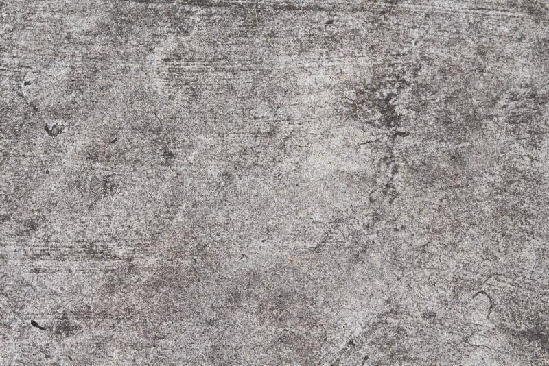 Struttura del calcestruzzo di Grunge Foto grigia di vista superiore della strada asfaltata Struttura afflitta ed obsoleta del fon immagine stock libera da diritti