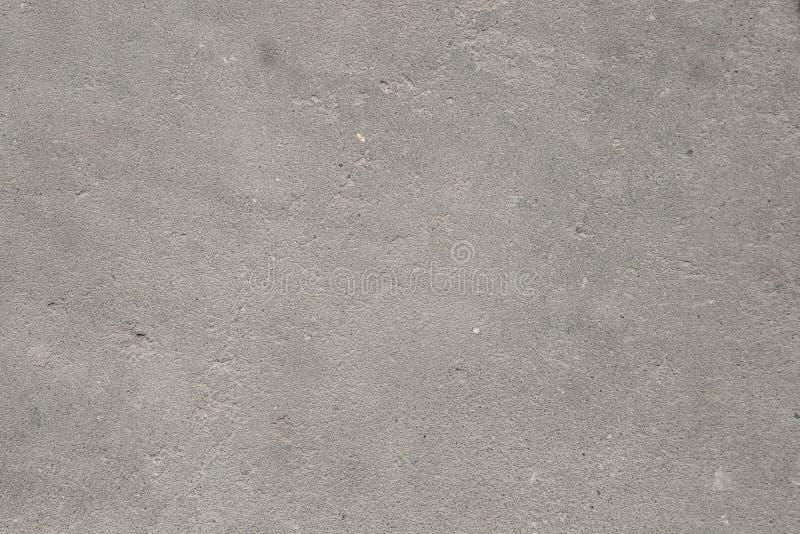 Struttura del fondo concreto del pavimento per effetto d'annata dell'estratto della creazione con rumore e grano fotografia stock