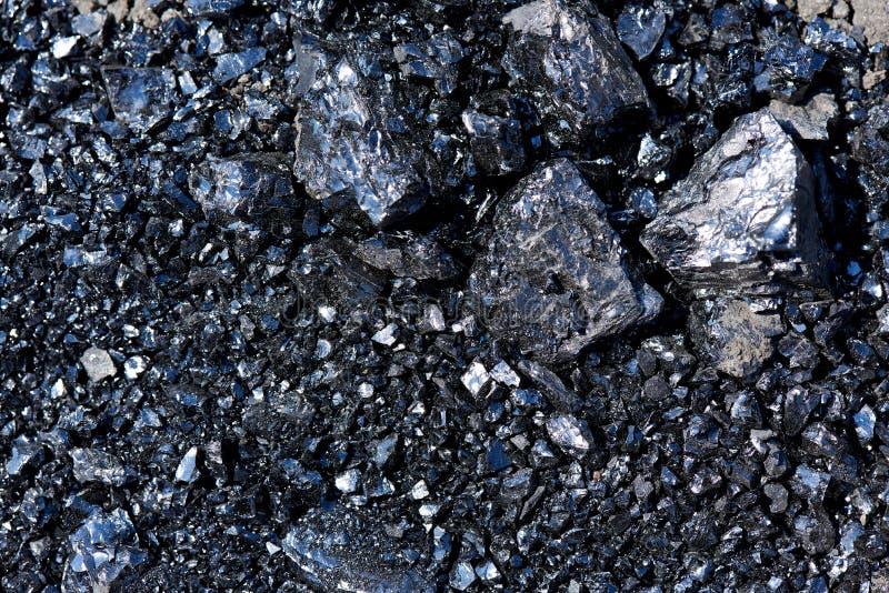 Struttura del fondo dei pezzi di primo piano del carbone fotografia stock libera da diritti
