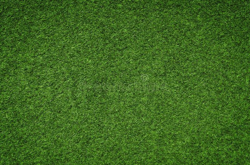 Struttura del fondo dell'erba verde, campo di erba artificiale fotografia stock libera da diritti