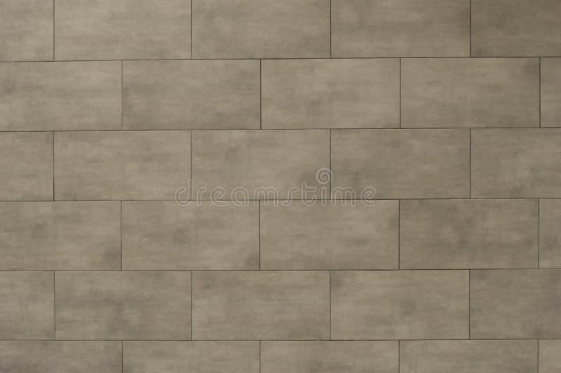 Struttura del fondo della parete delle mattonelle grigia immagini stock libere da diritti
