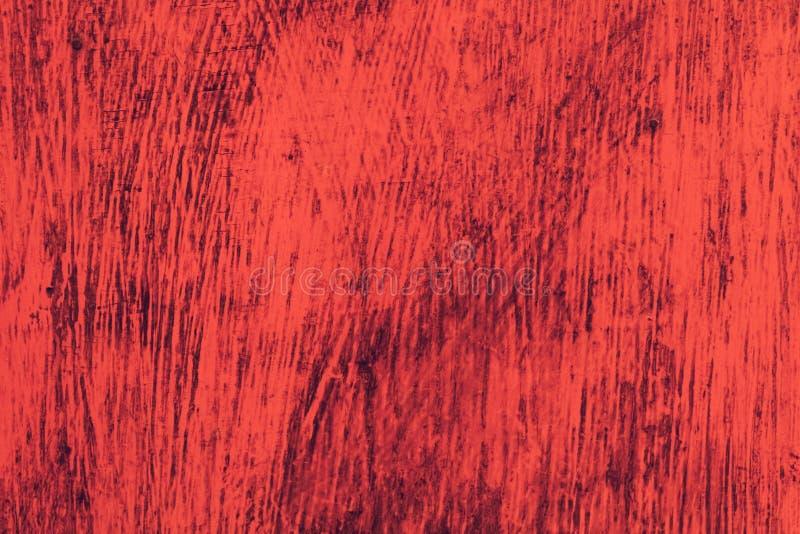 Struttura del fondo della tela Una parete di legno è coperta di vecchia pittura ricca luminosa immagini stock