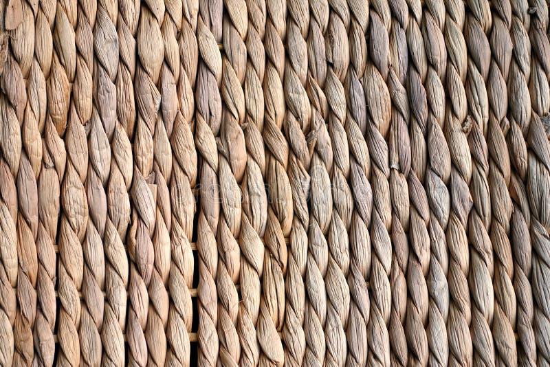 Struttura del fondo di beige o vimine o seagrass di colore paglierino fotografia stock