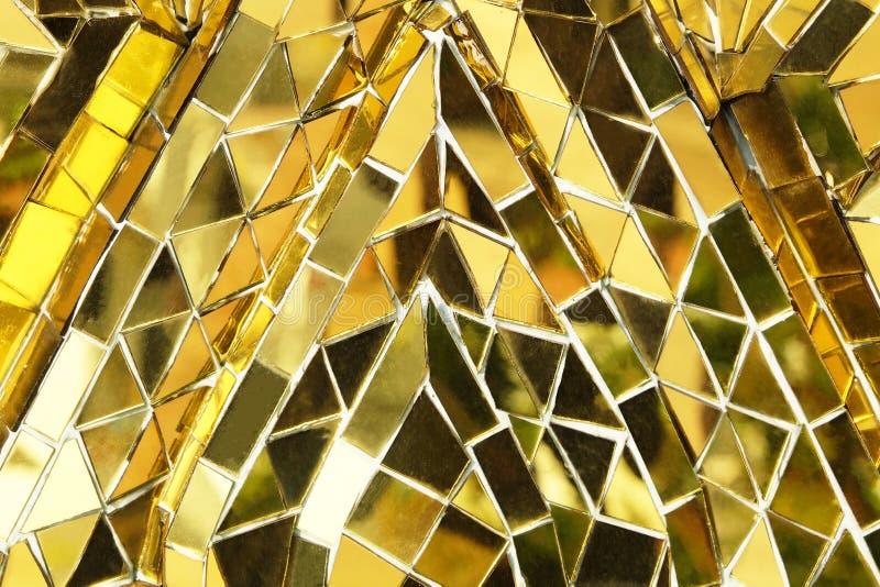 Struttura del fondo dorato del modello della parete del mosaico immagine stock