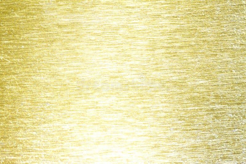 Struttura del fondo graffiata ottone dorato del metallo fotografie stock libere da diritti