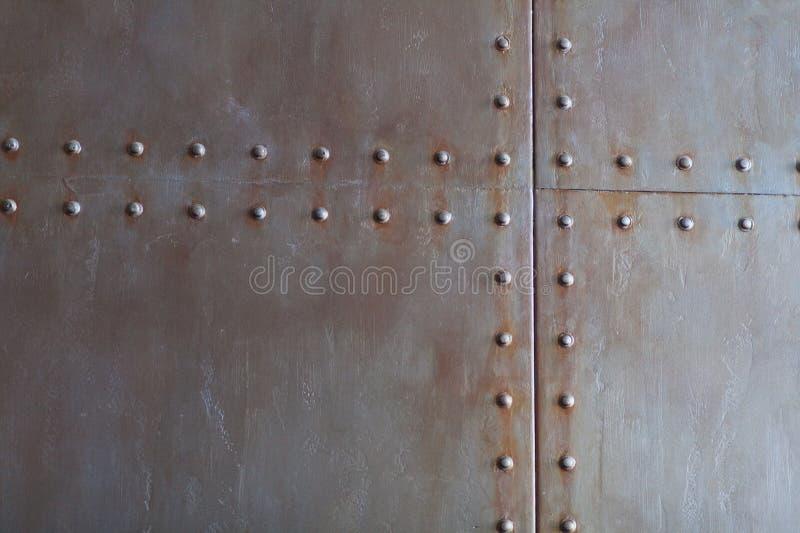 Struttura del metallo con i ribattini fotografia stock libera da diritti