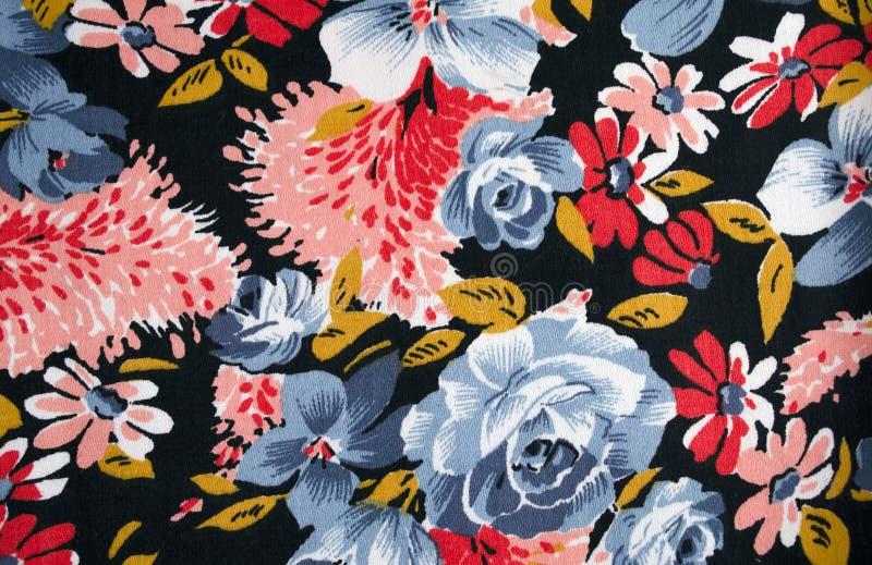 Struttura del tessuto con i fiori fotografie stock