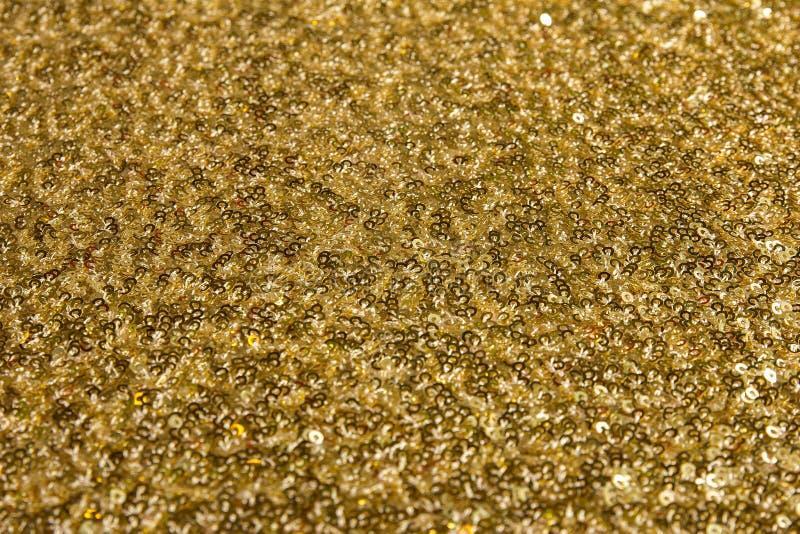 Struttura del tessuto dell'oro fotografia stock libera da diritti