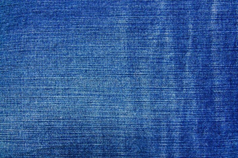 Struttura del tessuto delle blue jeans fotografia stock
