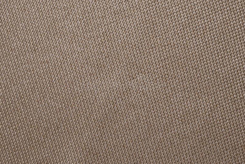 Struttura del tessuto di Brown di tela di sacco Fondo dell'abbigliamento Contesto del panno Modelli di licenziamento, insaccando  fotografia stock
