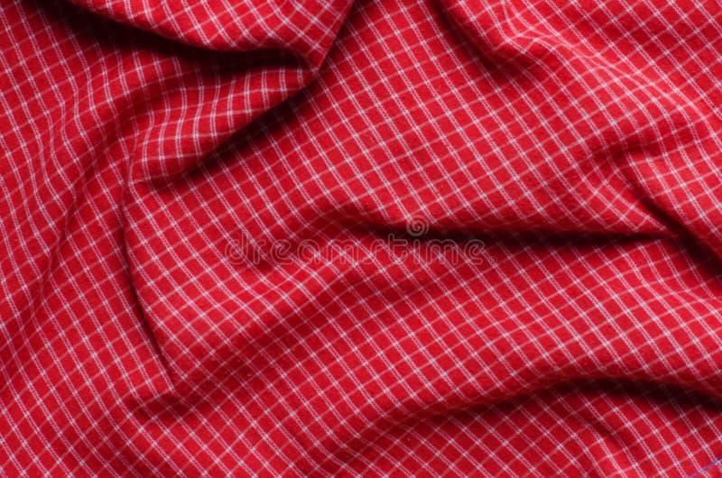 Struttura del tessuto rosso del percalle immagini stock libere da diritti