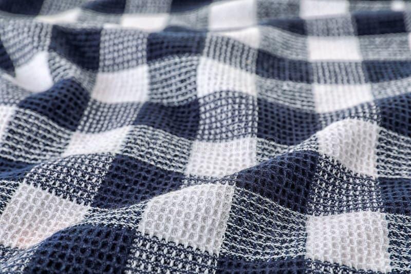 Struttura del tovagliolo di tavola del tessuto, primo piano immagini stock
