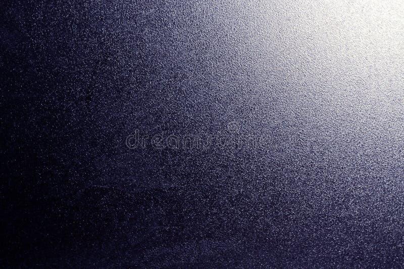 Struttura del vetro smerigliato nel colore blu con luce nell'angolo fotografia stock
