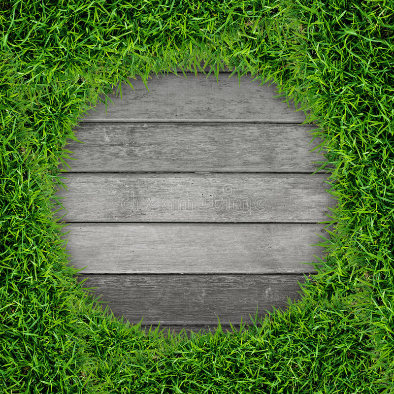Struttura dell'erba verde e fondo di legno dell'annata fotografia stock