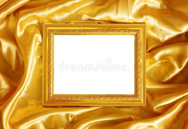 Struttura dell'oro sulla seta del tessuto fotografie stock