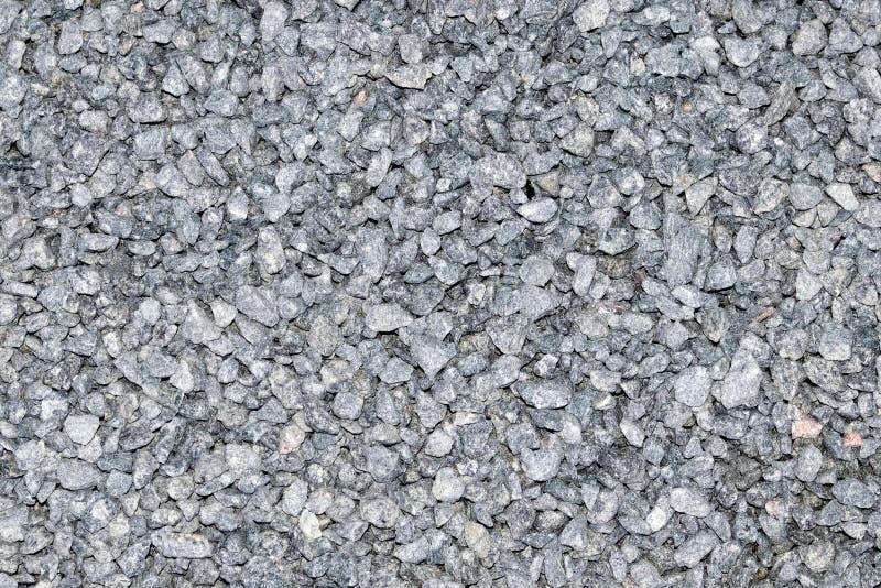 Struttura della briciola del granito Superficie granulosa grigia della roccia Granito bianco non lucidato come fondo fotografia stock libera da diritti