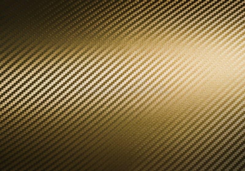 Struttura della fibra del carbonio dell'oro fotografia stock libera da diritti