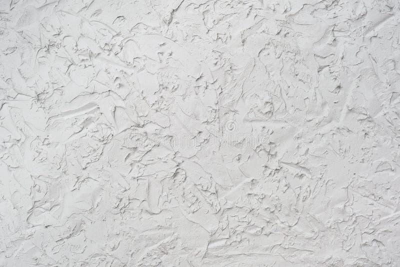 Struttura della fine decorativa dello stucco o del gesso su, fondo di pietra grigio dell'estratto fotografie stock libere da diritti