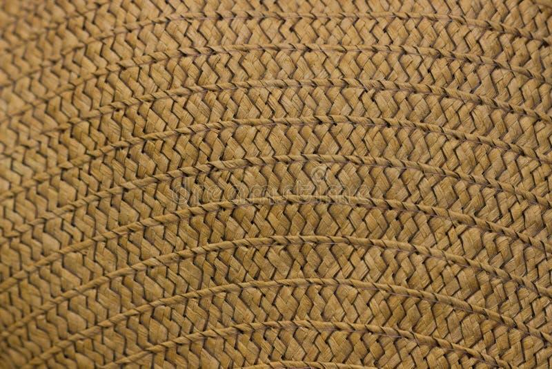 Struttura della fine del cappello di paglia su Il cappello di paglia, si chiude sul dettaglio fotografia stock libera da diritti