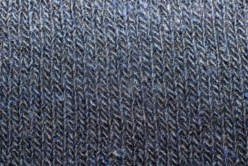 Struttura della fine tricottata blu del tessuto su immagini stock libere da diritti