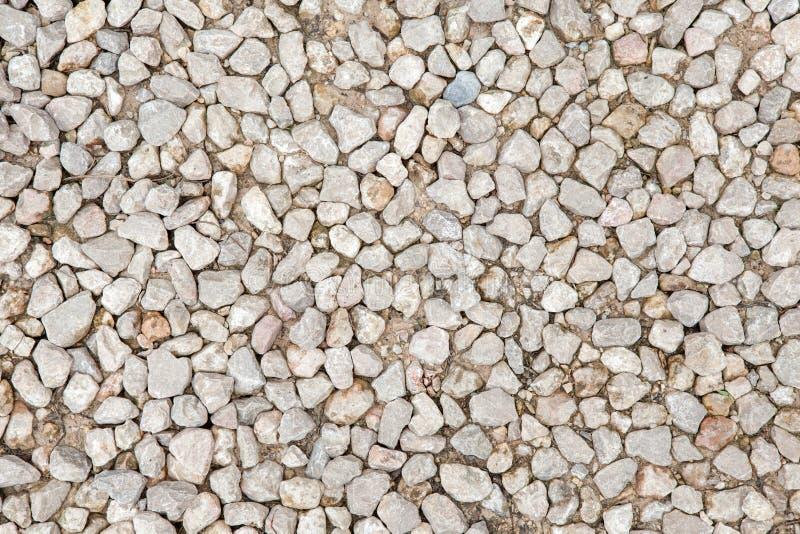 Struttura della ghiaia schiacciata roccia di pietra, fondo fotografie stock