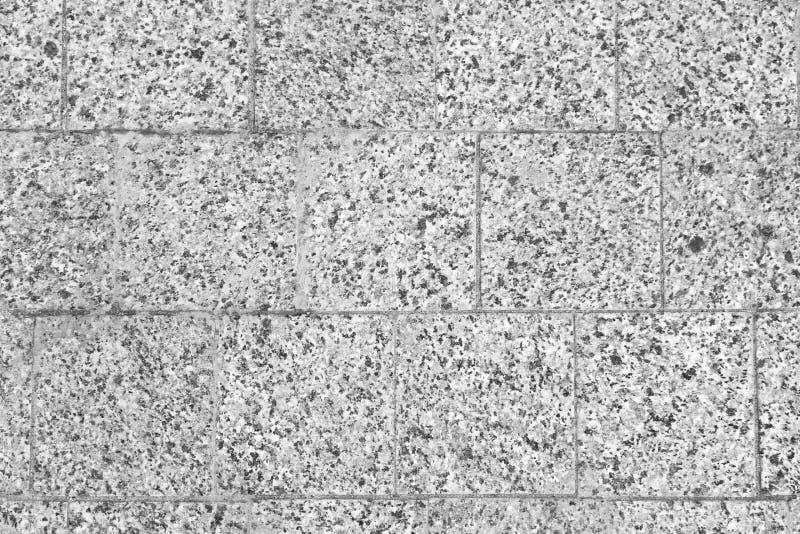 Struttura della parete con le mattonelle di pietra fotografia stock