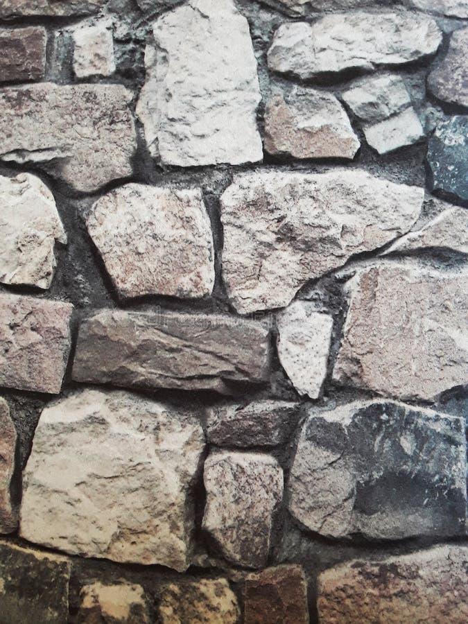 Struttura della parete di pietra Carta da parati di pietra di stile Progettazione esteriore immagine fotografia stock