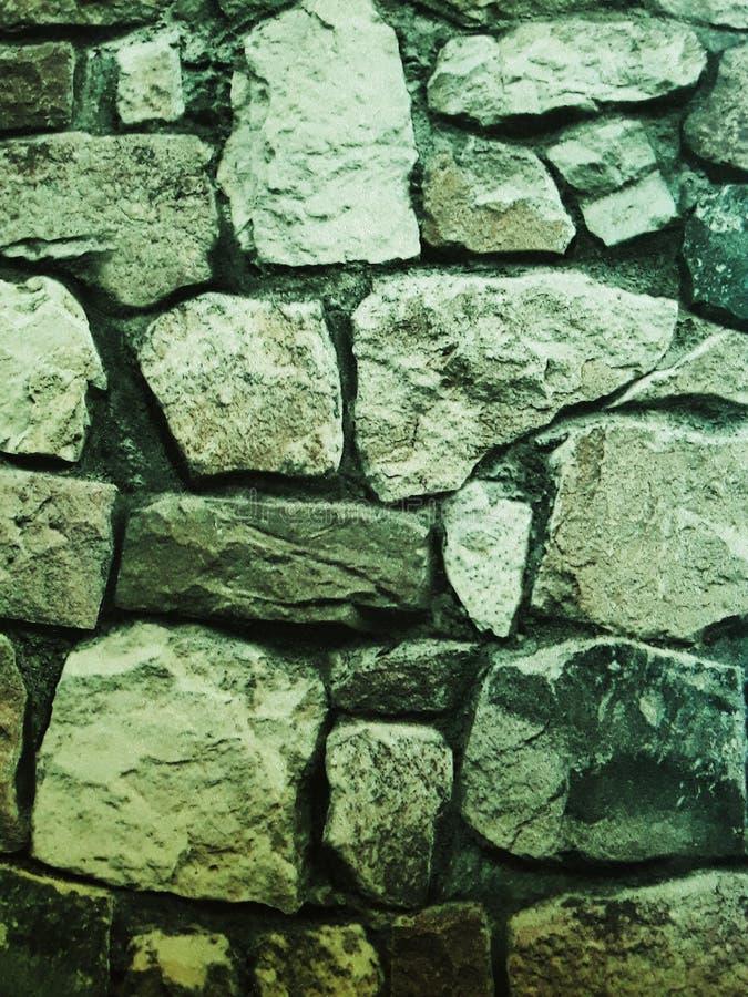 Struttura della parete di pietra Carta da parati di pietra di stile Progettazione esteriore immagine fotografie stock