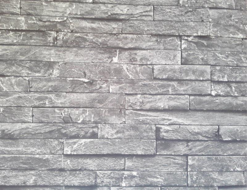 Struttura della parete di pietra Carta da parati di pietra di stile Progettazione esteriore immagine immagine stock