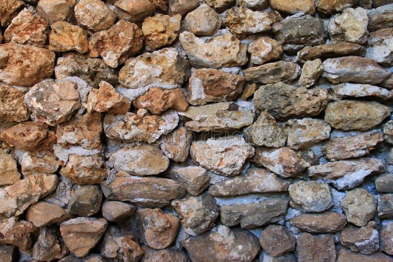 Struttura della parete di pietra Una parete di pietra della casa fare a mano per fondo o struttura immagini stock libere da diritti