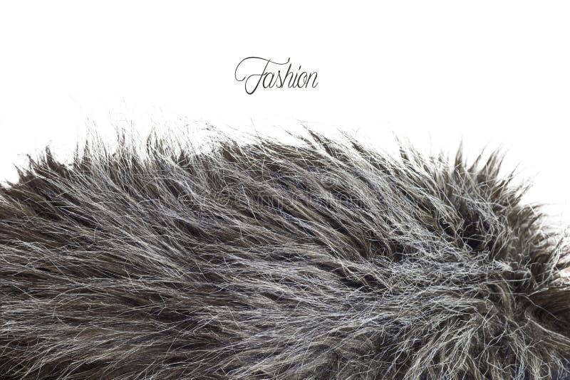 Struttura della pelliccia in a fondo grigio - modo di modo immagini stock