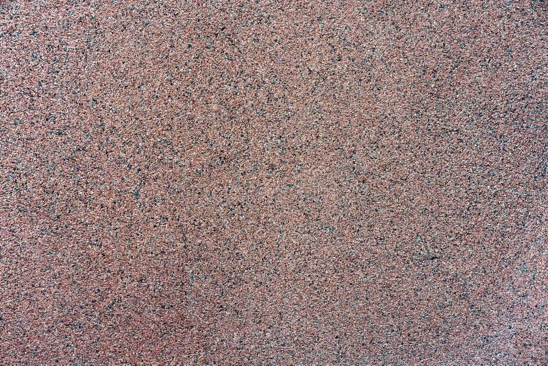 Struttura della priorità bassa della parete brown briciola del granito Briciola rossa del granito Parete di Colorfull decorata immagine stock