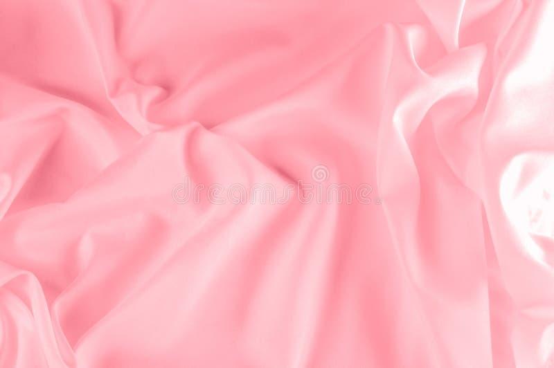 Struttura della priorità bassa rosa del tessuto di seta Questa seta di rosa della polvere ha tessuto immagine stock